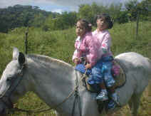 children riding vacation in monteverde