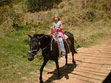 children horseback vacation in monteverde
