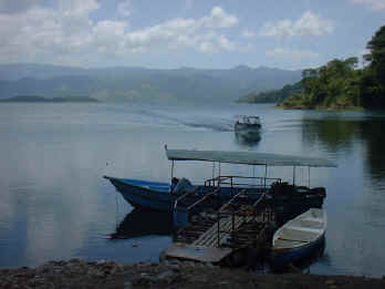 arenal lake at the dam - boat arrival