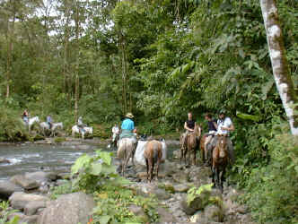 horseback riding crossing the river Cano Negro 1